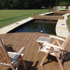 enhanced grain coppered oak millboard decking over pond