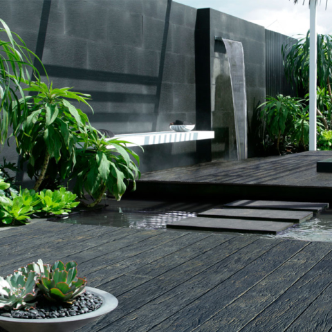 Weathered Oak Embered Decking by Millboard with Water Feature