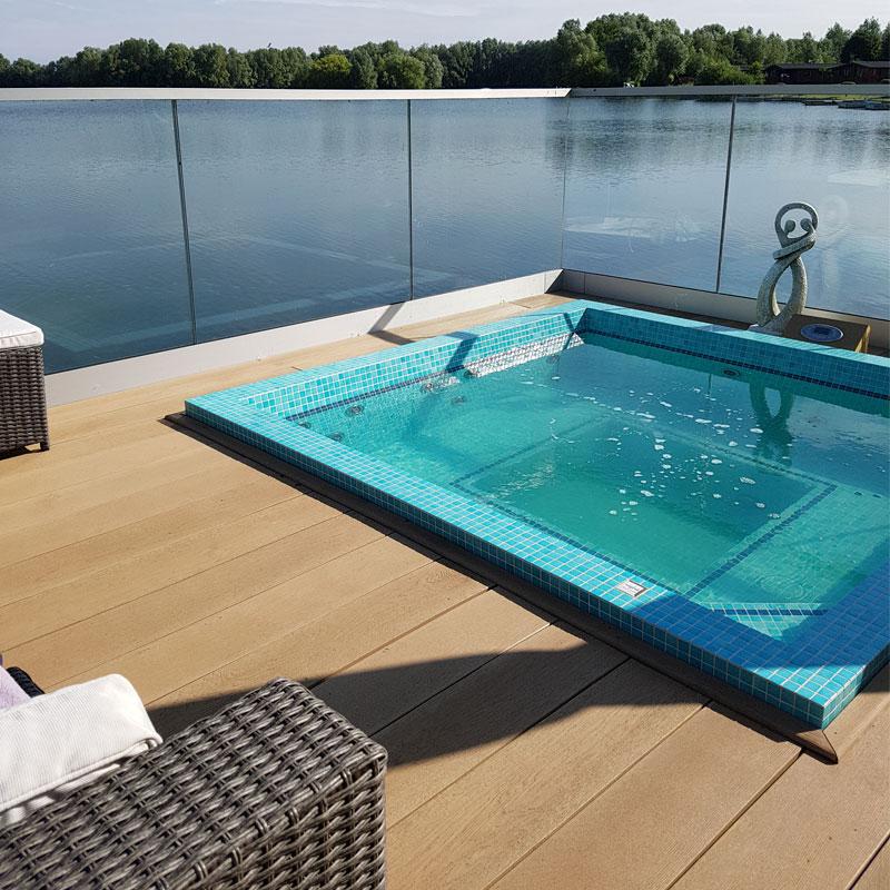 Enhanced Grain Golden Oak Millboard Decking Beside Pool-Lake