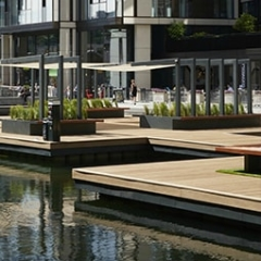 enhanced grain coppered oak millboard decking over water feature