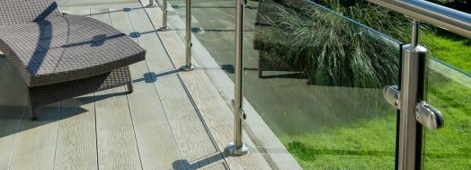 Enhanced Grain Limed Oak Millboard Decking With Glass Balustrades - total carpentry ireland - premium decking alternative to wood decking, plastic decking and composite decking