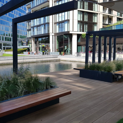 Floating Park Millboard Enhanced Grain Golden Oak Decking - terrace by water - total carpentry ireland